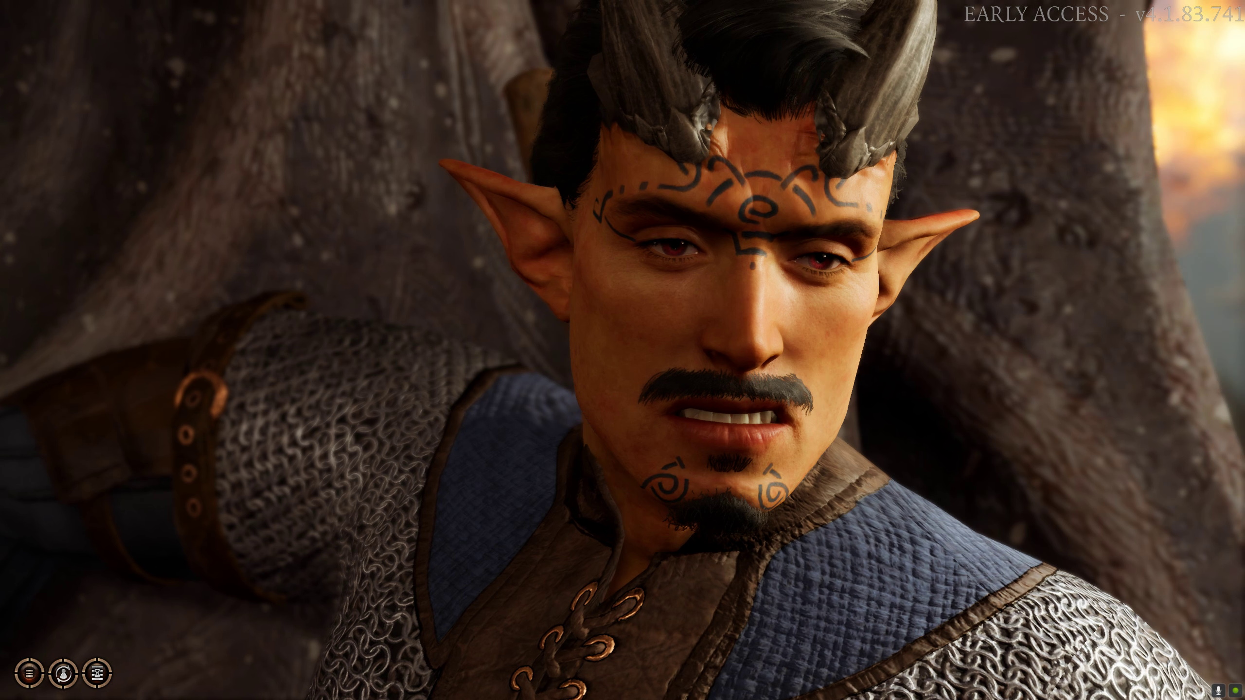 A screenshot of Matthew's custom player character in Baldur's Gate 3, a very smug looking Tiefling male, with a moustache and soul patch goatee, pointed ears, and big black horns protruding from his forehead and back over his skull.