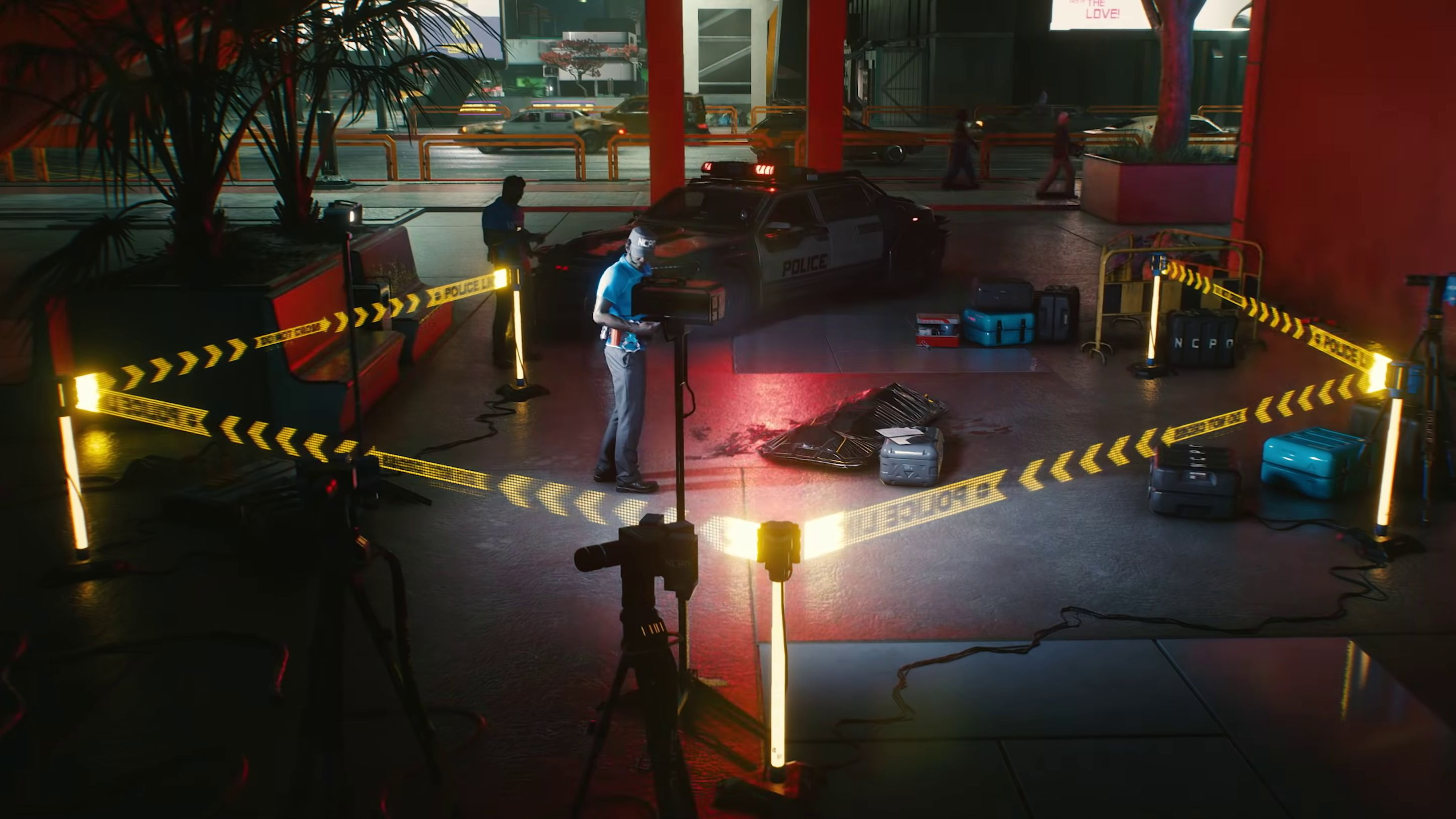 A screenshot from Cyberpunk 2077's gangs trailer showing some CYBERCOPS walking around a crime scene. There is a body bag and holographic police tape.