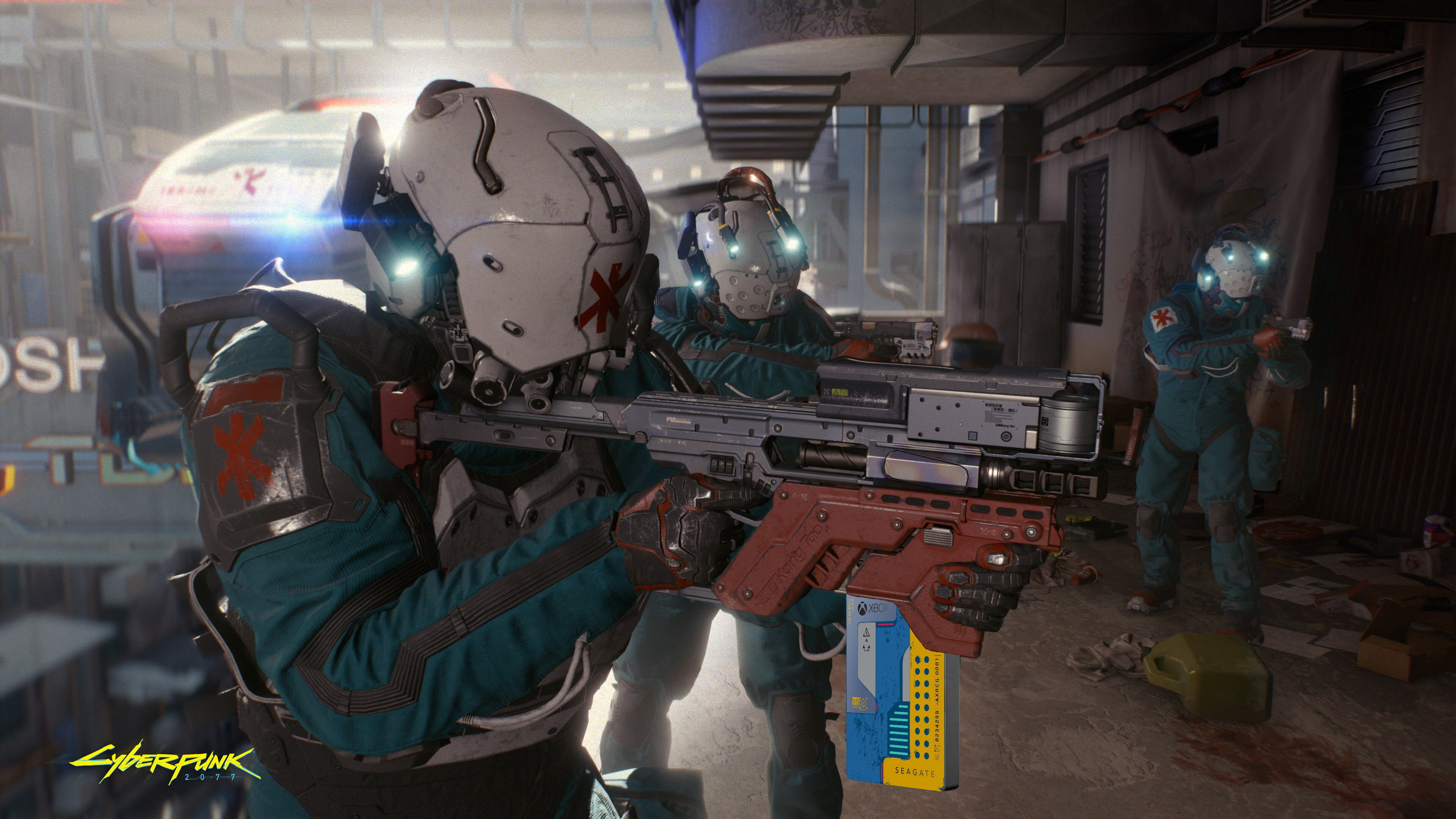 A militarised paramedic pointing a big gun, but the ammo clip is a blue and yellow Cyberpunk 2077 Seagate drive