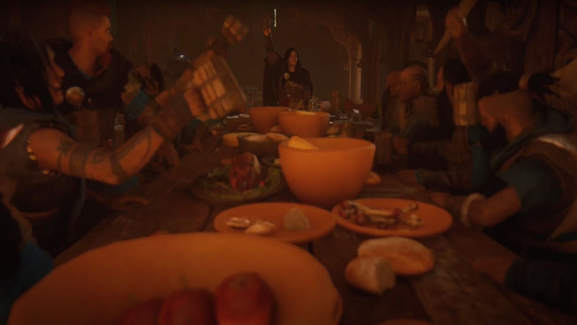 A great Viking feast in Valhalla. Plates and plates of food adorn the long table, everyone raises toasts!