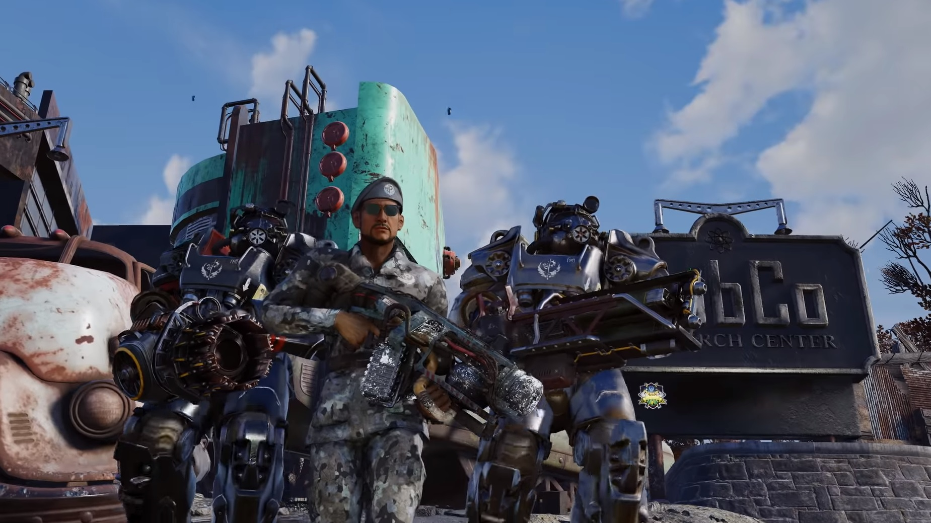 Two Brotherhood Of Steel soldiers in massive power armour standing either side of an officer in fatigues