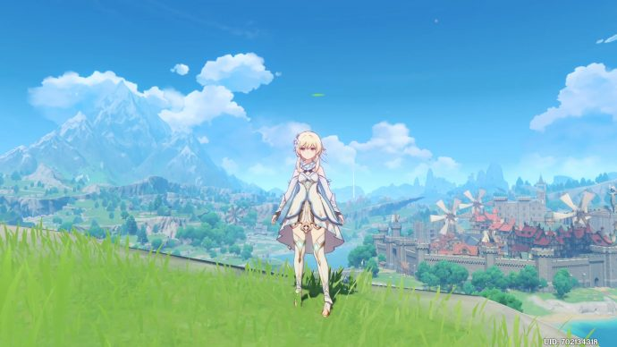 A screenshot of Genshin Impact's main character, with a beautiful countryside sprawling behind them.