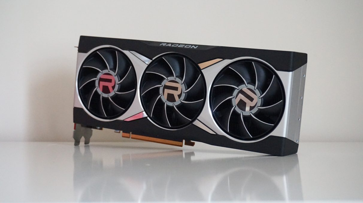 A photo of the AMD Radeon RX 6800 XT graphics card on a white table.