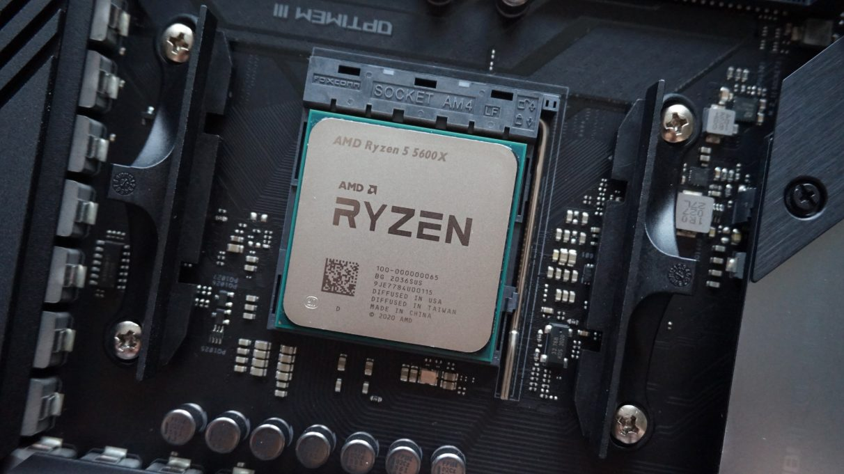 A photo of AMD's Ryzen 5 5600X seated in its AM4 motherboard socket.