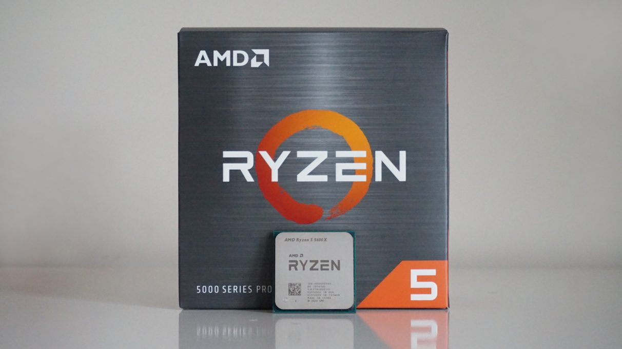 A photo of AMD's Ryzen 5 5600X CPU in front of its retail box.