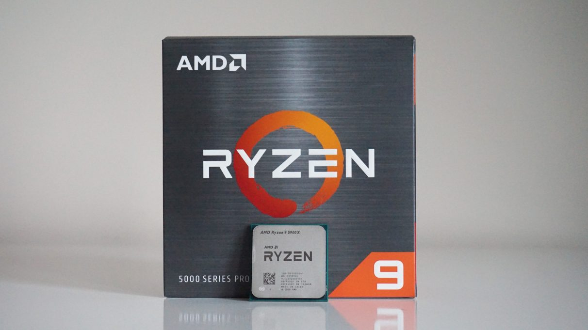 A photo of the AMD Ryzen 9 5900X CPU in front of its retail box.