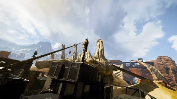 A screenshot of Pathfinder attaching his Grappling Hook to the top of a building.