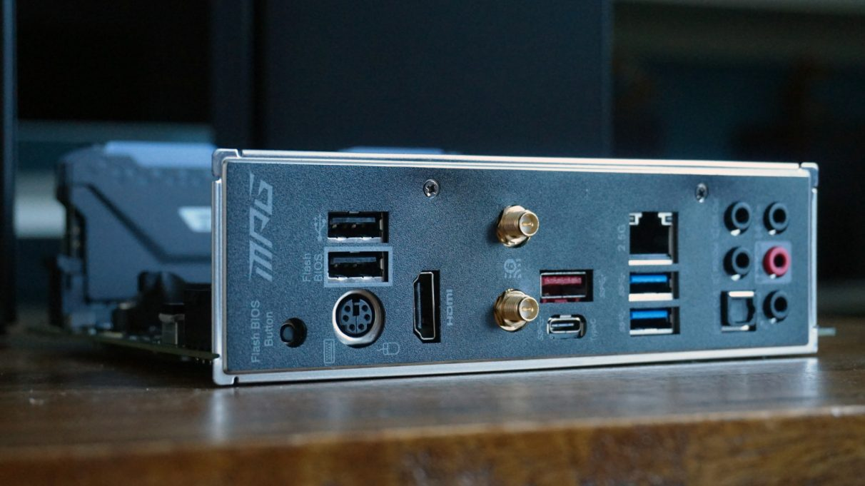 A photo showing the USB ports, Wi-Fi antenna and display outputs of a mini-ITX motherboard.