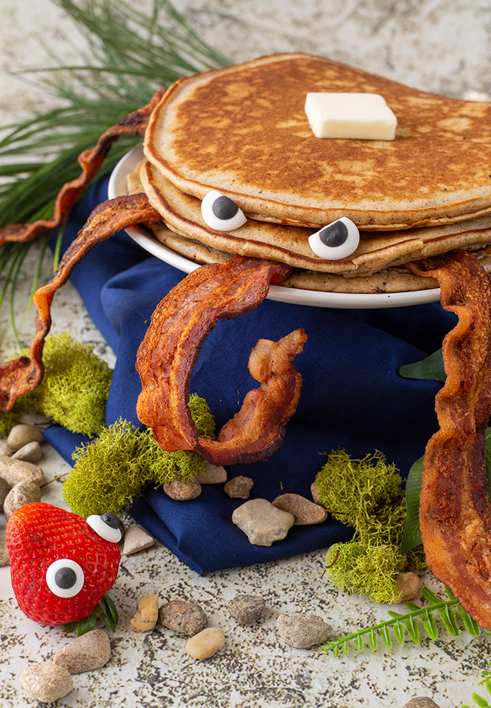 A Flapjackarak from Bugsnax recreated with actual pancakes and bacon.