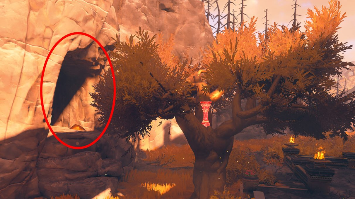 A screenshot highlighting the cave entrance behind the tree on the south-west side of the Midas Temple.