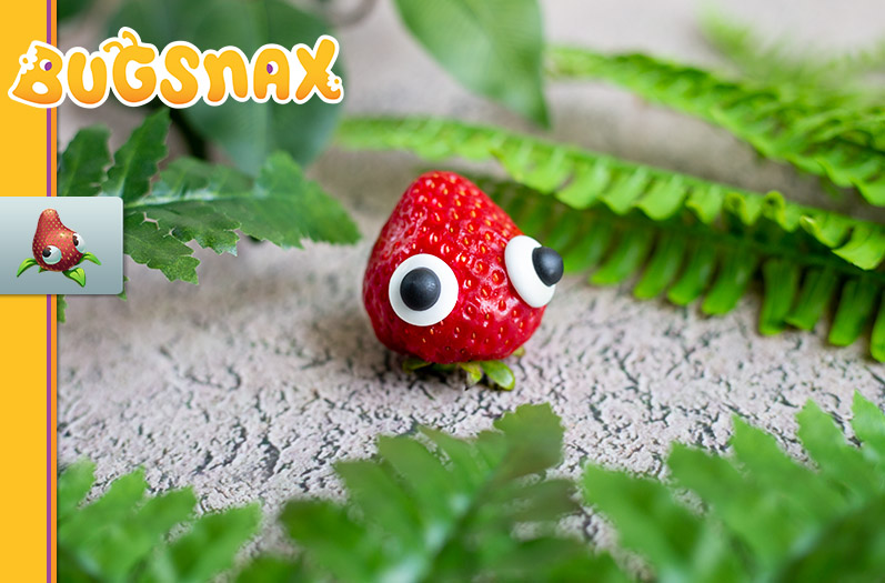 A Strabby from Bugsnax recreated with an actual strawberry and some edible googly eyes.