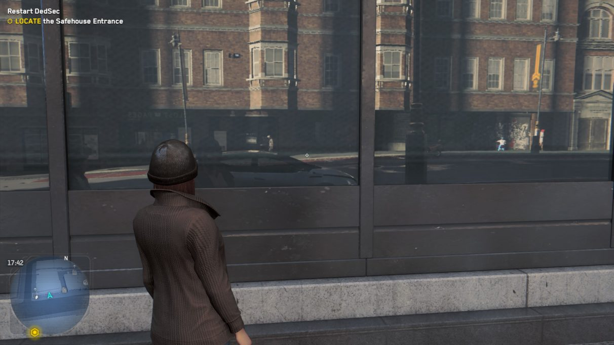 An image of a woman in Watch Dogs Legion staring at a reflective window to show what the game looks like with Ultra ray tracing.
