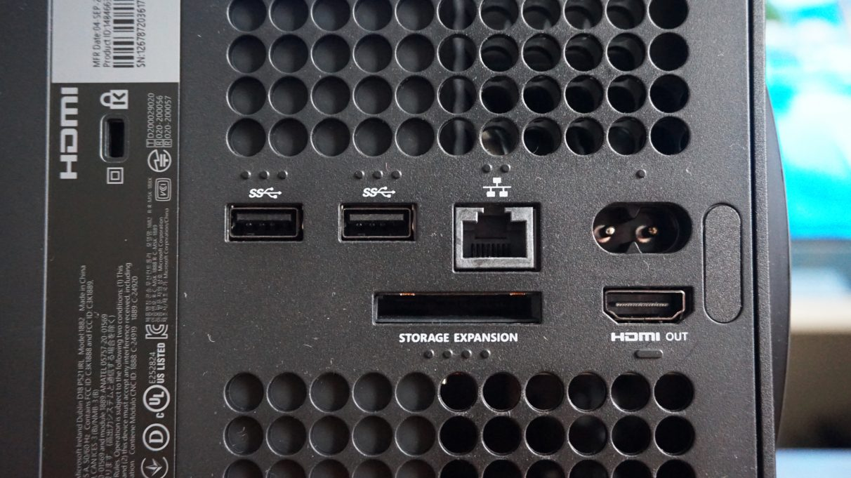 A close-up photo of the Xbox Series X's rear display output, USB ports, Ethernet port and SSD expansion slot.