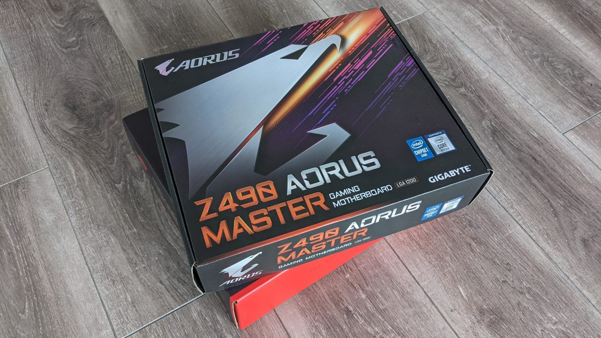 A photo of Gigabyte's Z490 Aorus Master motherboard box on a wooden floor.