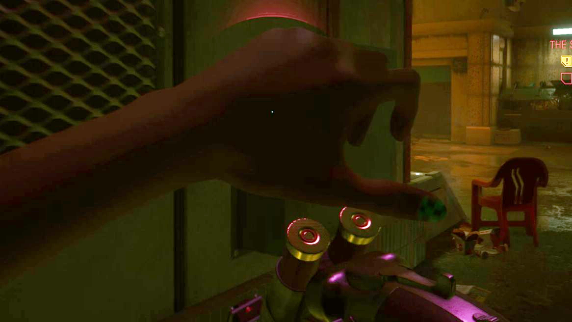 A screenshot of V reloading a shotgun in Cyberpunk 2077, showing their left hand thumbnail painted in a green and black check design