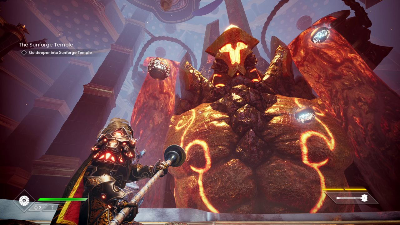 The player character in Godfall looks up at a giant male torso carved from volcanic rock. It has a pointed helmet, and two rivers of lava are falling over its shoulders.