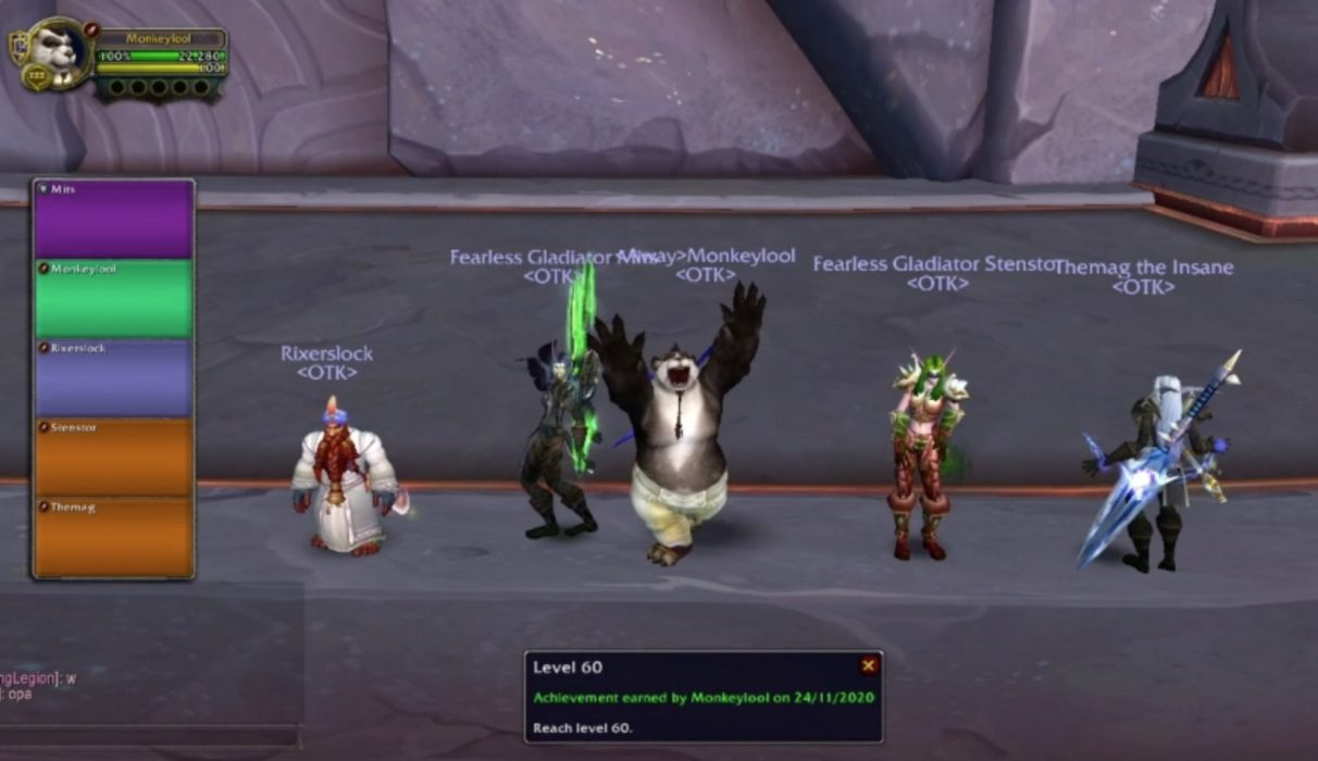 Four Warcraft players celebrate against a wall.