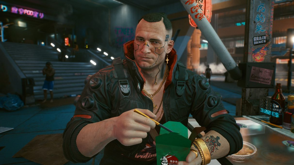 A screenshot of Jackie from Cyberpunk 2077 eating a cup of noodles from a street food stand.