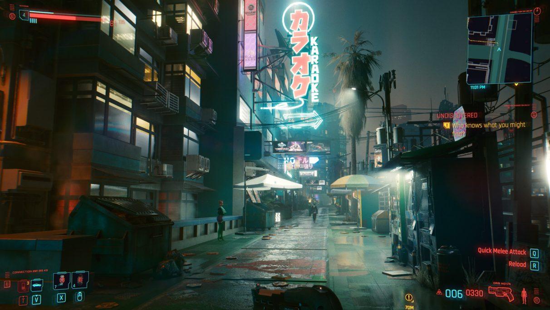 A screenshot of an alley at night in Cyberpunk 2077 on RT Medium settings.