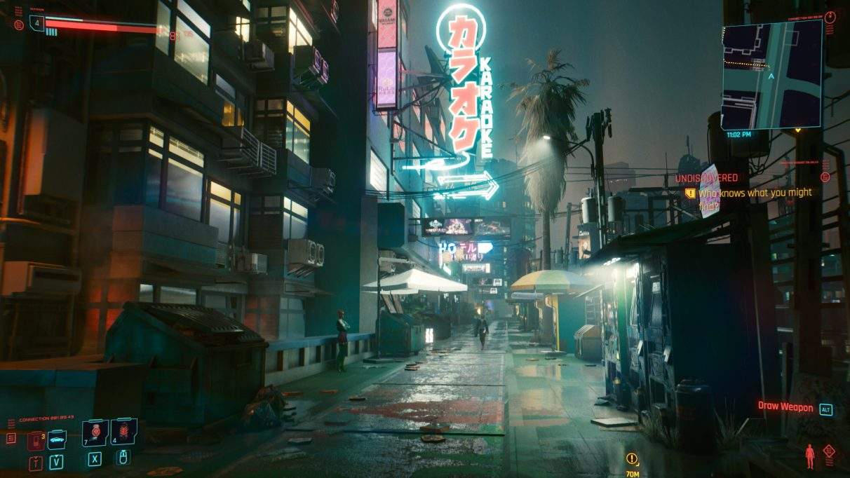 A screenshot of an alley at night in Cyberpunk 2077 on Ultra settings.