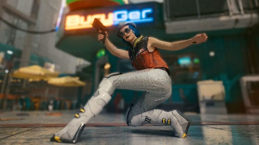 A screenshot of my V - the one from the header image - but now doing a kind of action pose pretending to crouch and shoot at something. Here we can see the sleeveless jacket is paired with skin-tight silver sequinned trousers, and knee-high grey plastic boots with wedge heels.
