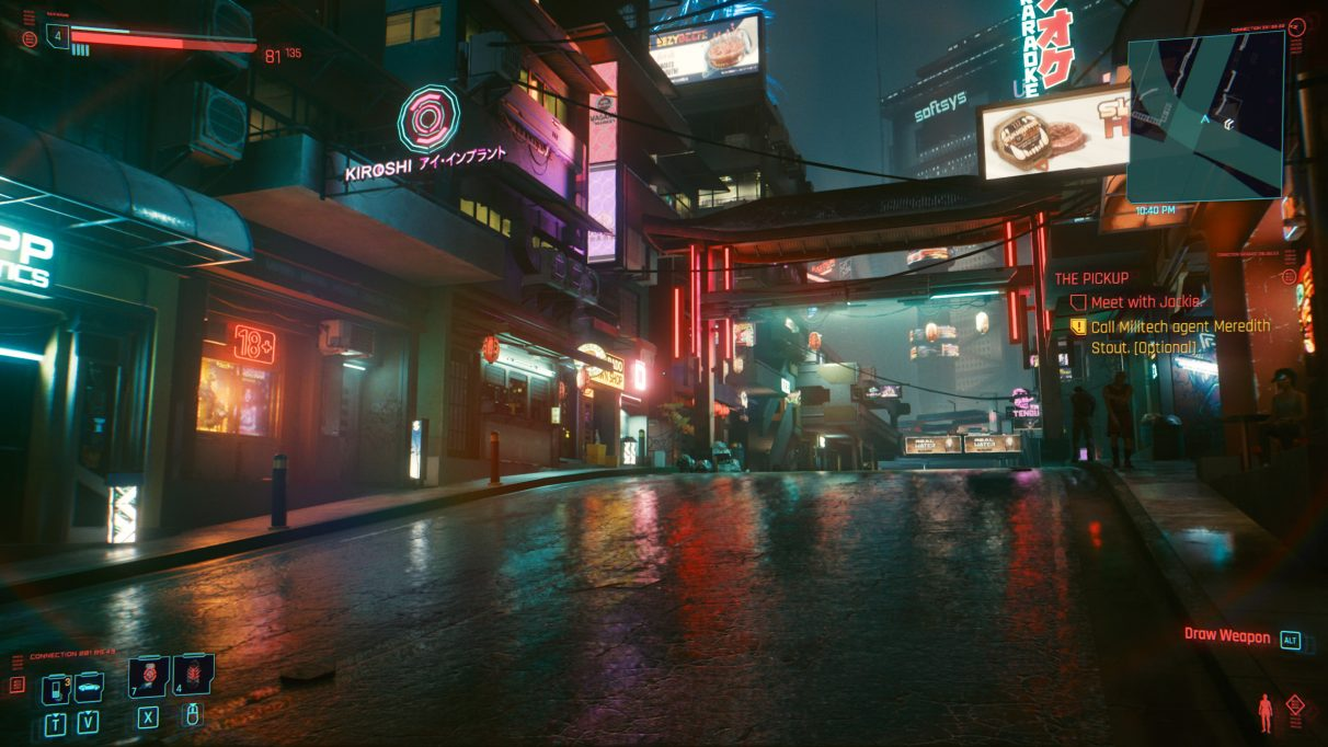 A screenshot of a street in Night City in Cyberpunk 2077 with RT Ultra settings.