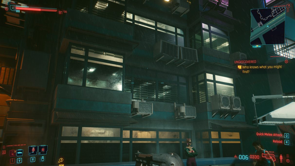 A screenshot of a series of windows at night in Cyberpunk 2077 with RT Medium settings.