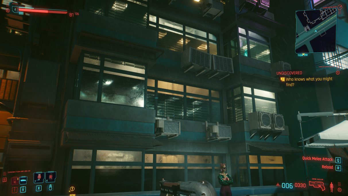A screenshot of a series of windows at night in Cyberpunk 2077 with RT Ultra settings.