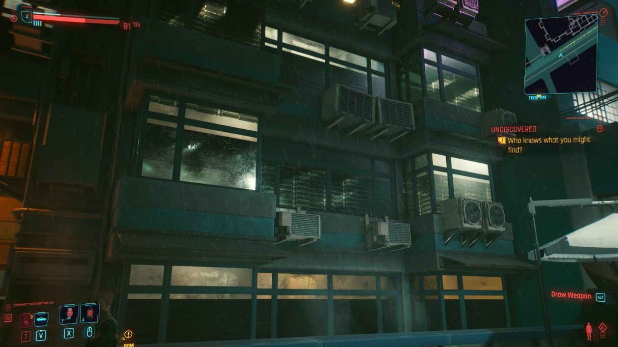 A screenshot of a series of windows at night in Cyberpunk 2077 with Ultra settings.