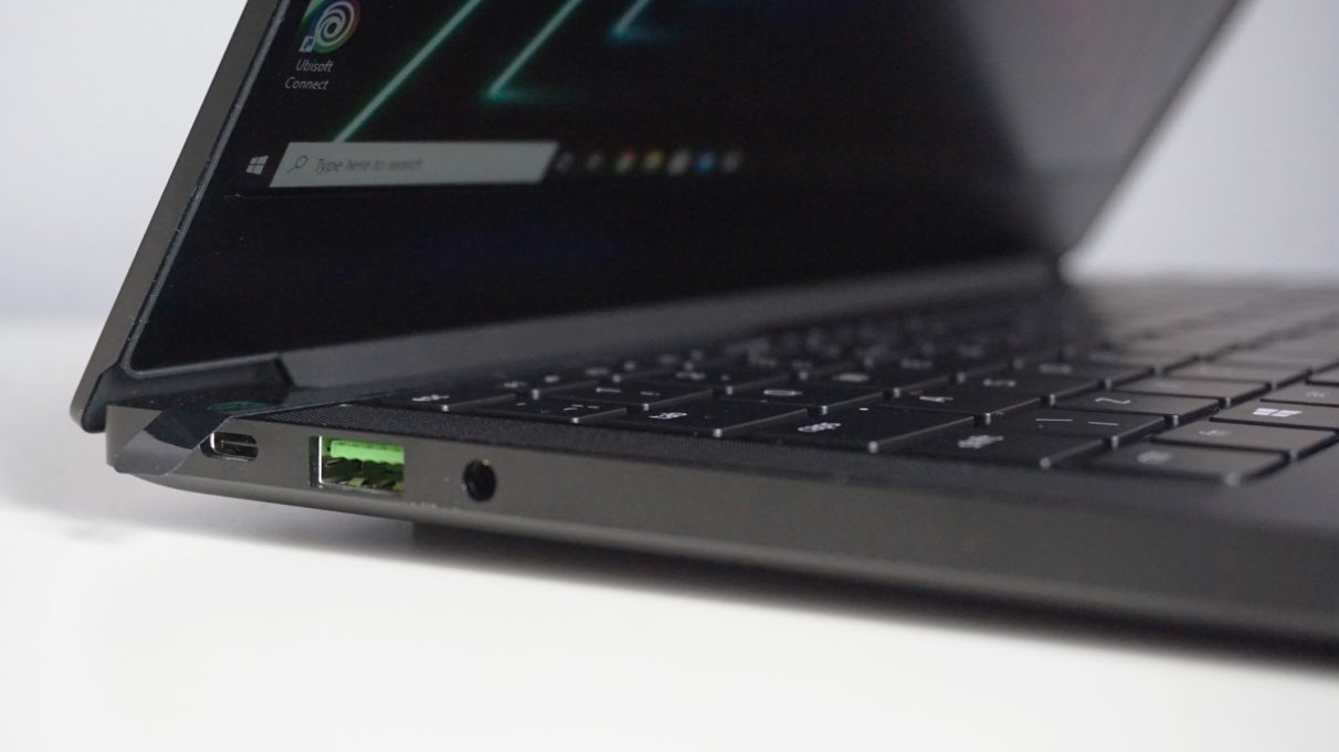 A photo of the Razer Blade Stealth 13 Late 2020 gaming laptop's left Thunderbolt 4 port, USB3 port and combined headphone and microphone jack.