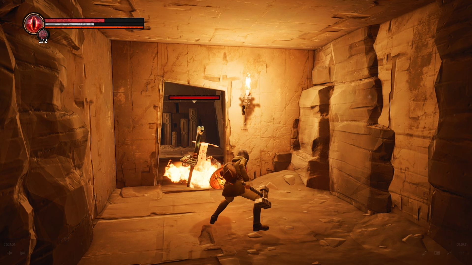 I fight a mage in a stone corridor dimly lit by the orange glow of a torch.