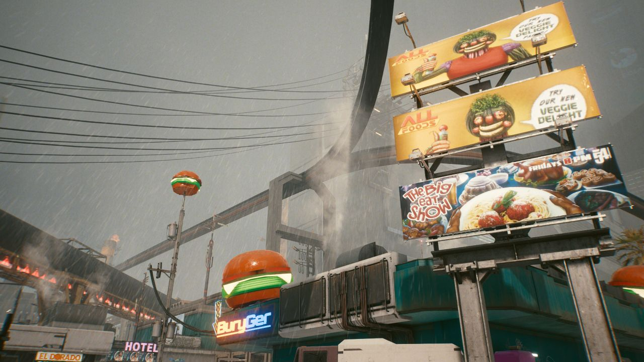 It is raining. We can see the top of a takeaway restaurant called BuryGer, which does also have a model burger on the roof. Above it are power lines, and the track for a monorail. Next to it is an ad board showing two ads for All Food Veggie Delight, and a TV show called The Big Eat Show