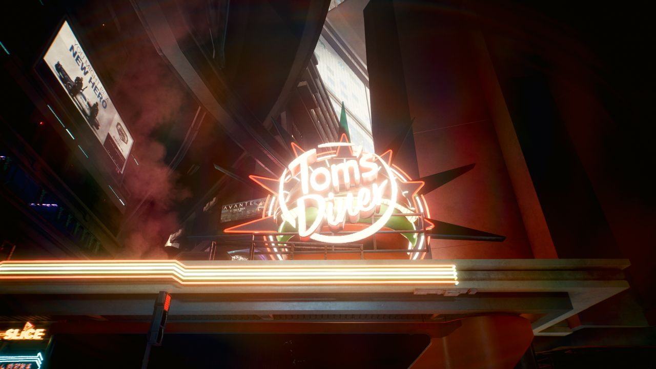Papan neon bertuliskan'Tom's Diner' dengan font bulat yang ramah. Di belakangnya ada burger model 3D besar, dengan paku hijau dan oranye menyembur dari dalamnya