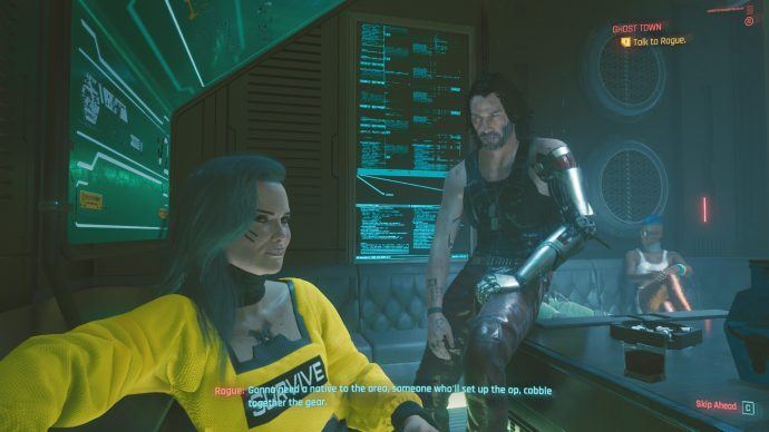 A nightclub scene in Cyberpunk 2077, in which a character named Rogue is speaking to the player while a glowing, holographic cyber Keanu Reeves stares daggers at Rogue.