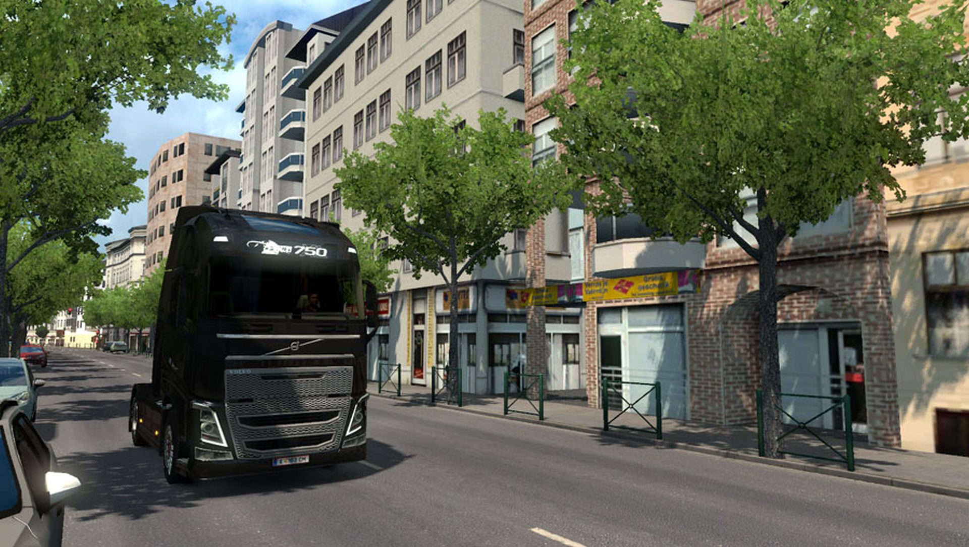 A Euro Truck Simulator 2 mod showing a black truck driving along the streets of Paris