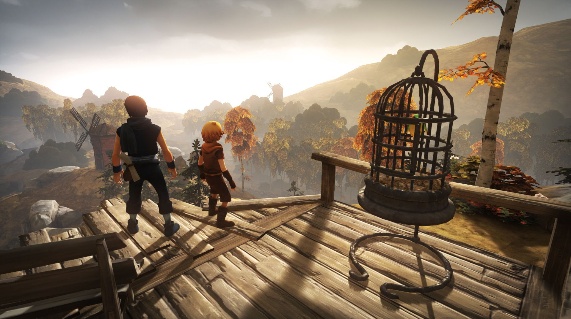 A screenshot of the two brothers in Brothers A Tale Of Two Sons, standing on a wooden platform and looking out on a valley.