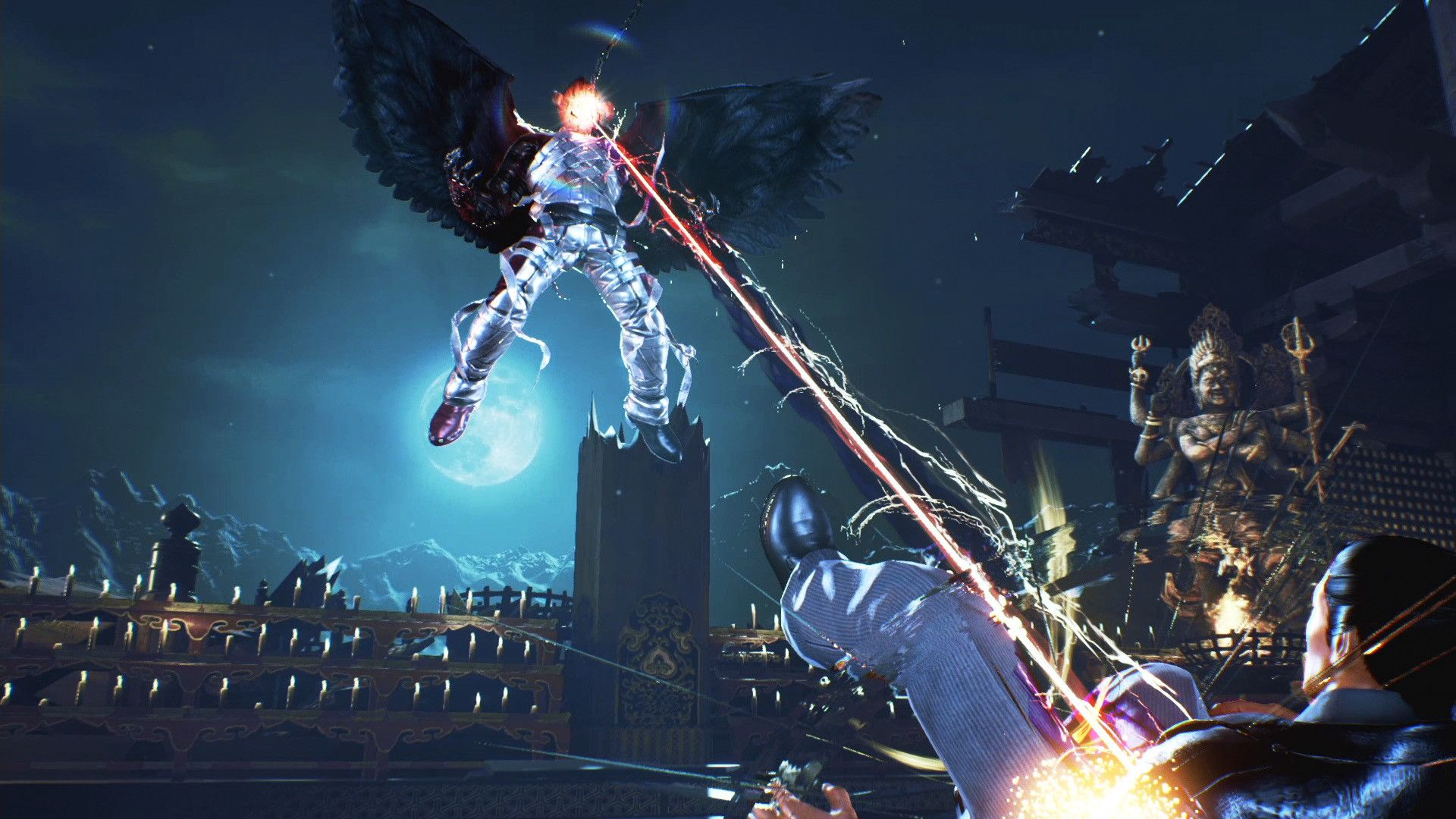 One of the Mishimas levitating in the air with big angel wings, blasting another Mishima with eye lasers. I am unsure which Mishima in either case.
