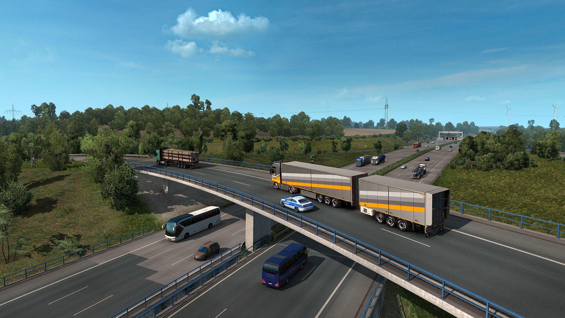 Tangkapan layar Euro Truck Simulator 2 menunjukkan truk melintasi jalan raya yang sibuk menggunakan jembatan