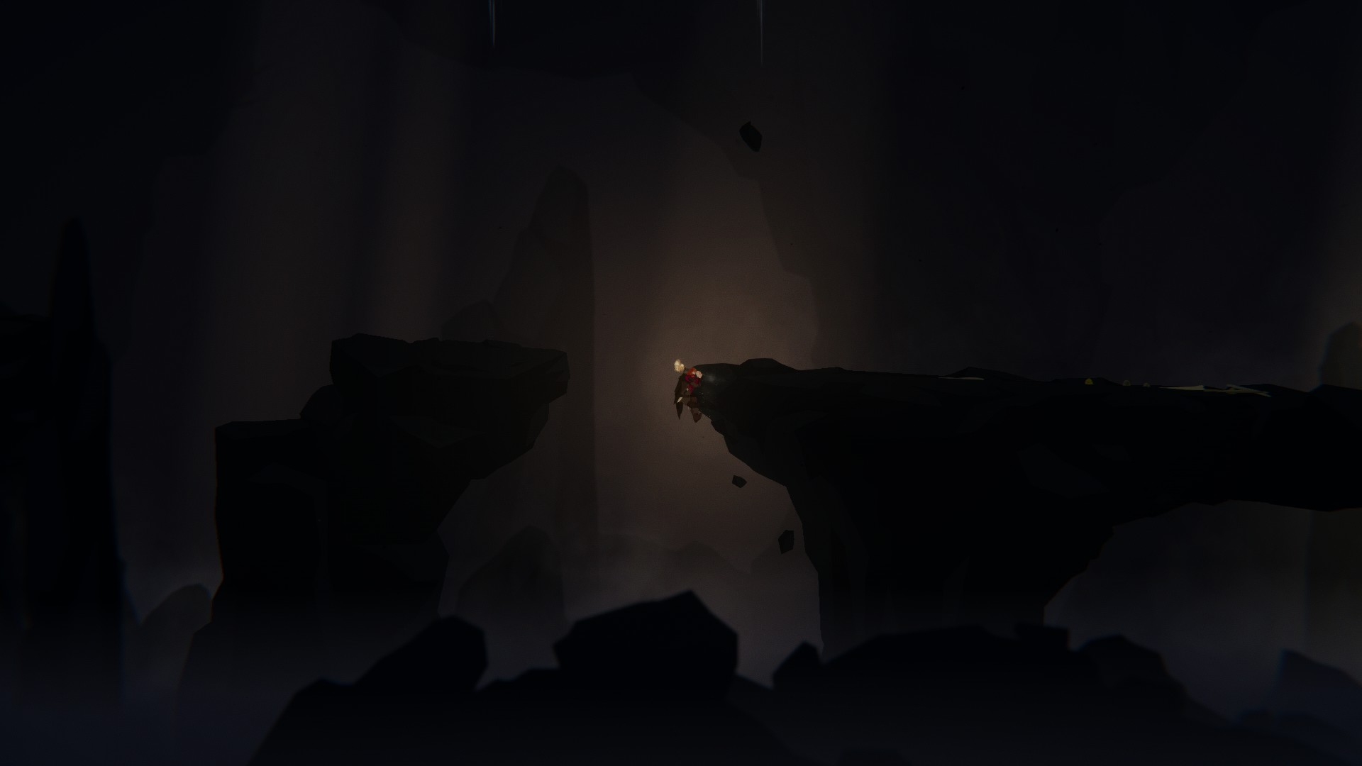 Our man is holding a torch, in a gloomy, dark cave. He is on a rocky outcrop and looks like he has just jumped over a gap in it, just barely grabbing the other side.