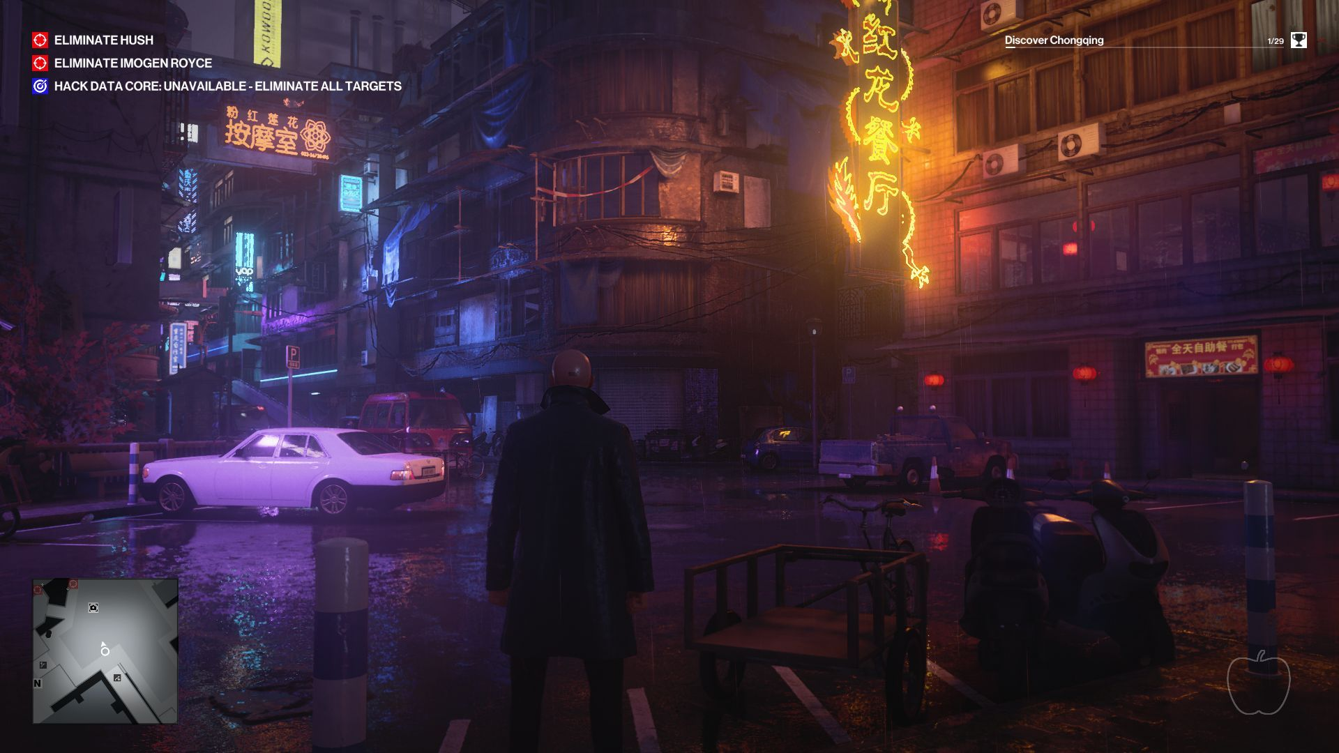 Agent 47 stands on a dense street corner in China, looking at some neon signs