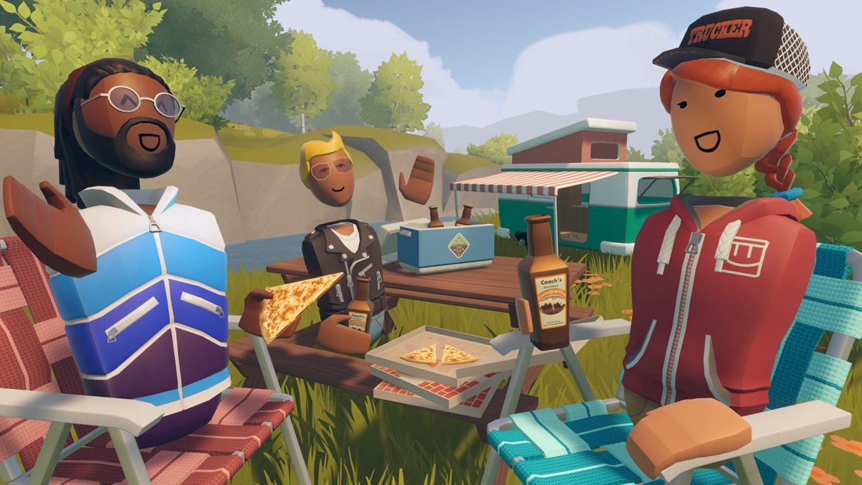 Pals sharing some pizza round a table in VR game Rec Room.
