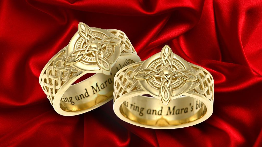 A photograph of two Ritual of Mara rings, with knotwork inspired by Skyrim's Amulet of Mara.