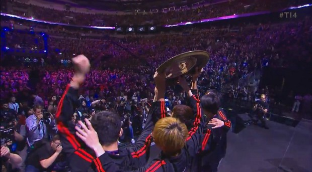 Newbee lift the Aegis, a shield inscribed with the names of winners.