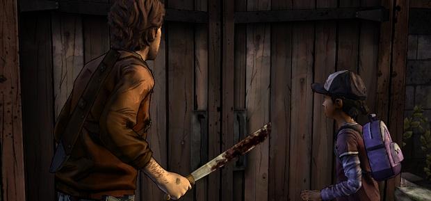 Clem looking at a barn door.