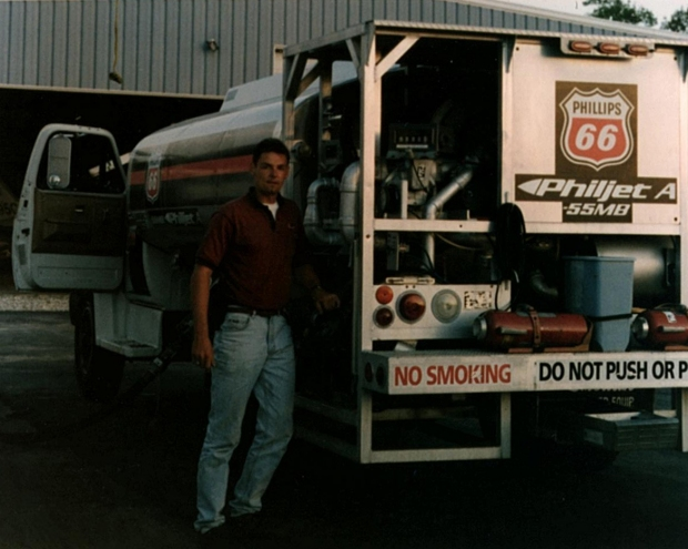 """After college graduation, 1995, pumping gas on the flightline of Ramp 66, North Myrtle Beach airport, South Carolina to pay for additional flying."""